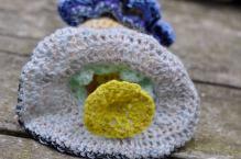 Snerlelignende blomst hæklet i merinould