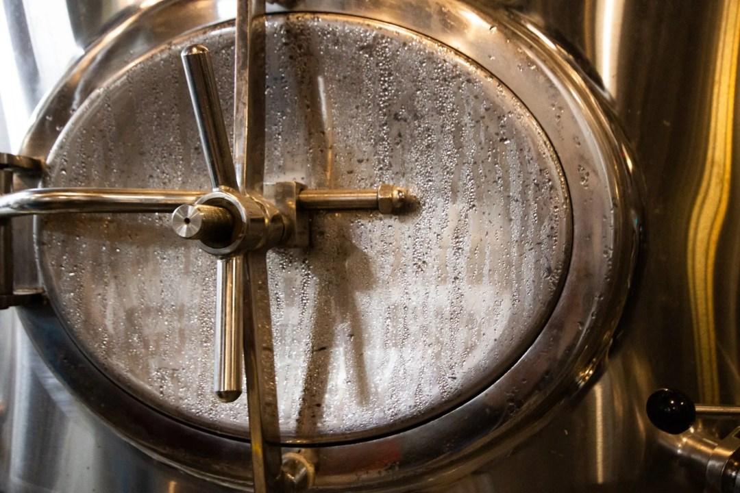 Closeup photo of a beer tank door