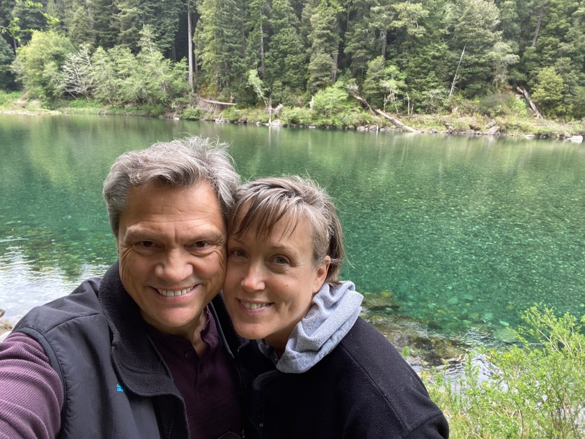 Couple standing in front of the Smith River