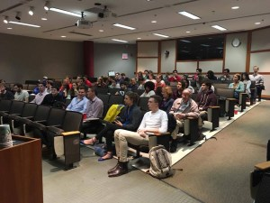 A packed crowd attends the first HIRS talk.