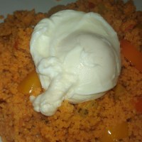 Couscous with peppers and poached egg on top