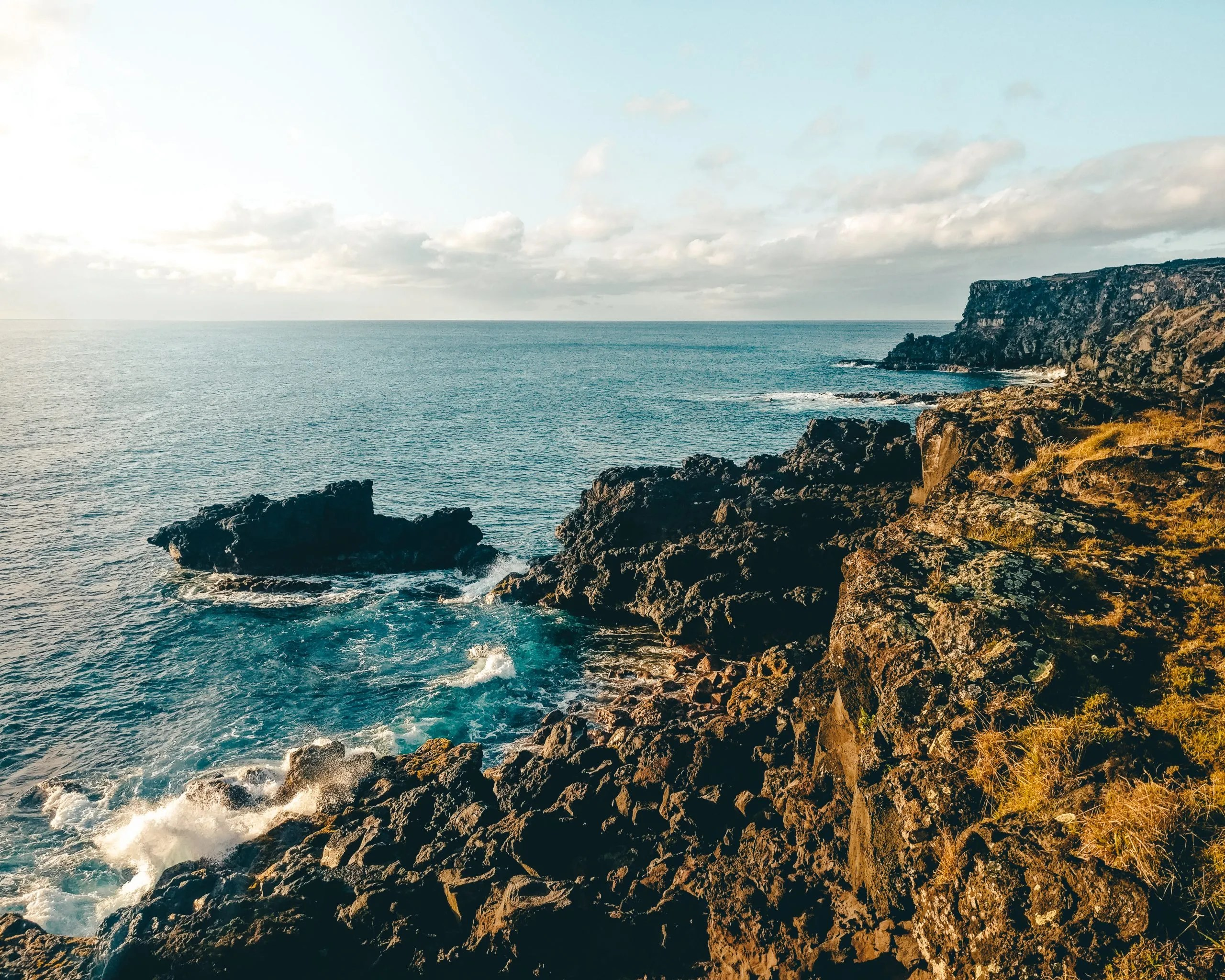 The cliffs of easter island in the middle of the pacific ocean.