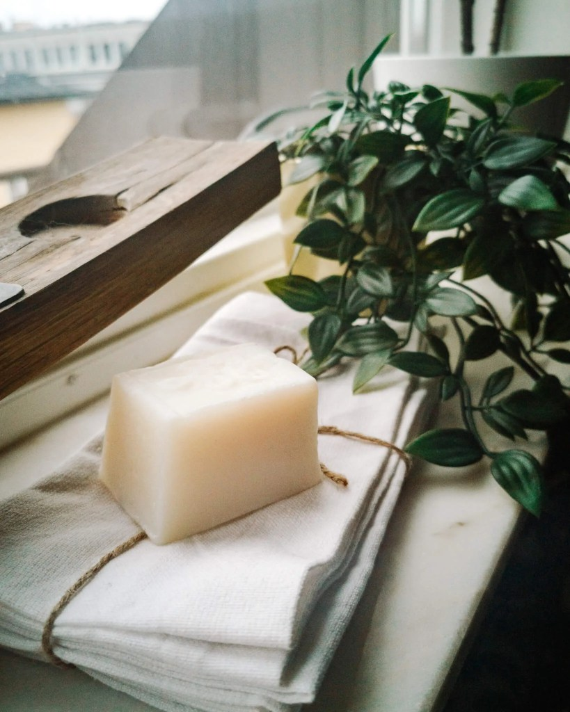 A sustainable deodorant bar laying on a linen cloth