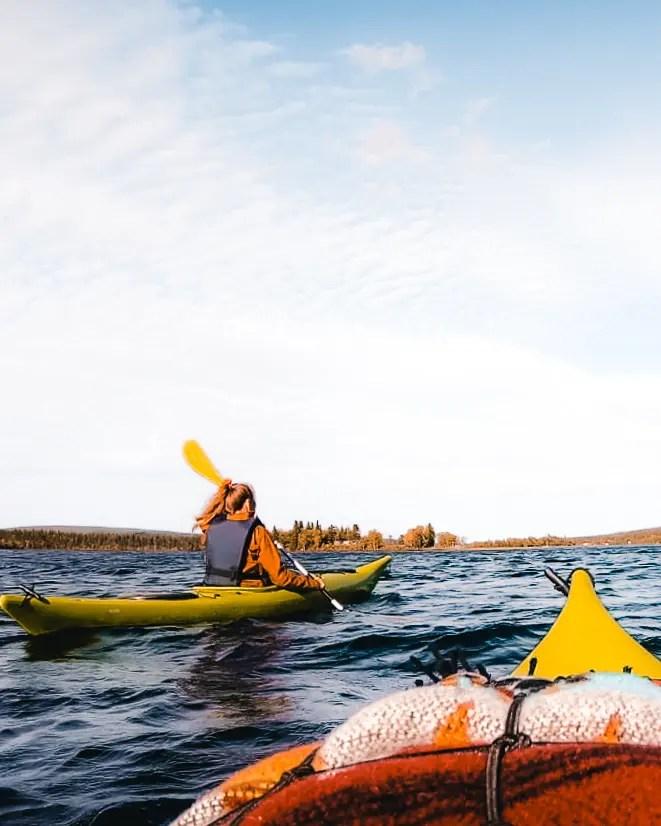 Kayaking on a lake in Swedish Lapland.
