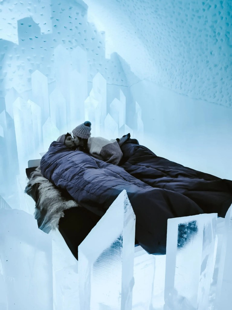 A couple sleeping in one of the art rooms at Sweden's ice hotel.