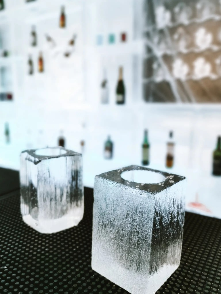 Shot glasses made from ice at the ice bar in ice hotel Sweden.