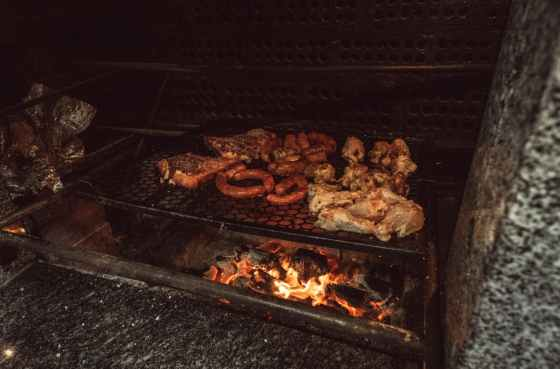 grilled meat on black charcoal grill at nighttime
