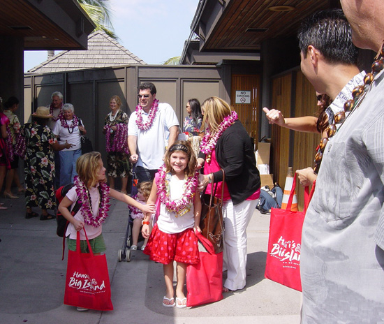 Some of the first passengers off the inaugural Alaska Airlines flight from Oakland looked happy to be in Hawaii. (Photo courtesy of BIVB)