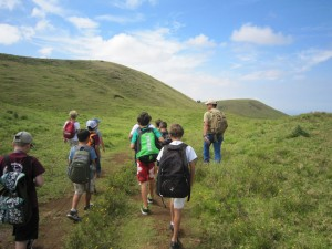 Parker Ranch land manager Brandi Beaudet leads Parker School fourth graders on a hike to the top of Puu Hokuula.