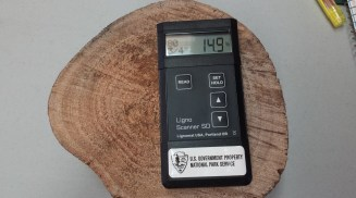 For stability, lumber needs to have been properly dried prior to use in the construction of an object. Curtis let us try out his scanner to determine moisture content. Photo Credit: J. Sommer