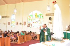Father Juan Pablo Galeano with the congregation at St. John the Baptist, Kalihi, Feb. 5.