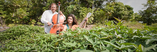Nelson and Dorothea serenade a sweetpotato patch at Amy Greenwell Ethnobotanical Garden in Captain Cook.