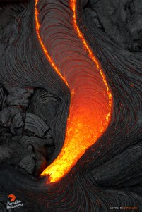 A molten stream of pahoehoe cools along its edges, creating a collection of intricate ropey braids that will likely not be seen by another human being, as once the breakout's surface solidifies, another will cover it, obscuring these beautiful patterns forever.