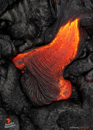 A small toe of lava oozes from beneath a crusted lobe of the March 5th flow.