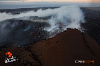 Slight glow can be seen emanating from the lava pond near the center of the frame.