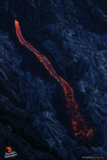 A river of lava flowing down Pulama Pali transitions from pahoehoe at its source, to 'a'a at its leading edge, due to the shear strain and increasing viscosity.