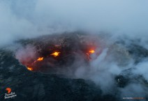 Toxic gases kept us at bay for a bit, but breaks in the plume gave us peeks at the lava pond.