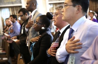 WASHINGTON, DC - JULY 03: New U.S. citizens participate in a Pledge of Allegiance during a naturalization ceremony at the Treasury Department July 3, 2013 in Washington, DC. More than 7,800 people will become citizens at more than 100 special ceremonies, as part of the United States Citizenship and Immigration Services' (USCIS) annual celebration of Independence Day, across the country and around the world from July 1 to July 5. (Photo by Alex Wong/Getty Images)