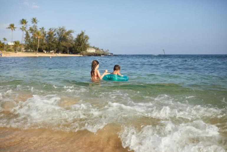 The Best Kauai Beaches for families featured by top US travel blog, Hawaii Travel with Kids: Find out the best Kauai beaches for families with little kids.