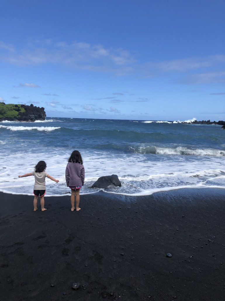 3 Day Maui Itinerary with Kids featured by top Hawaii travel blog, Hawaii Travel with Kids: Black Sand Beach, Wai'anapanapa State Park, Maui is great stop on the Road to Hana on Maui with kids