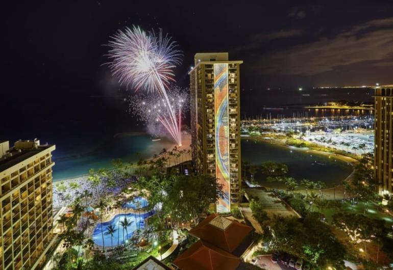Top 6 Free Things to Do on Oahu featured by top Hawaii blog, Hawaii Travel with Kids: The Hilton Hawaiian Village has a free fireworks in Waikiki show every Friday