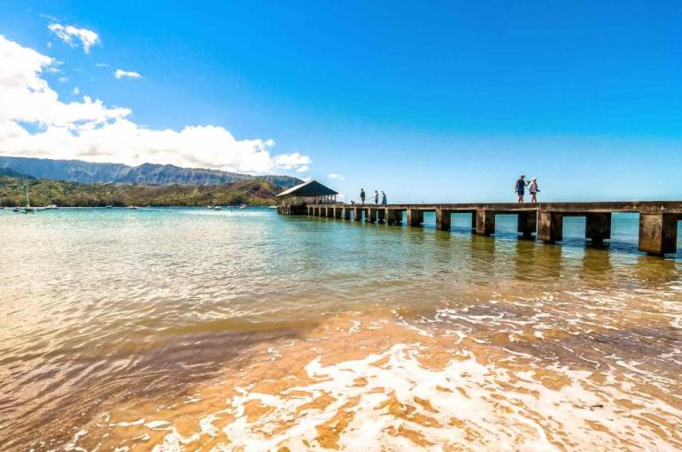 50 Best Places to Visit in Hawaii with your Family featured by top Hawaii blog, Hawaii Travel with Kids: Hanalei Bay is a popular North Shore Kauai snorkeling beach