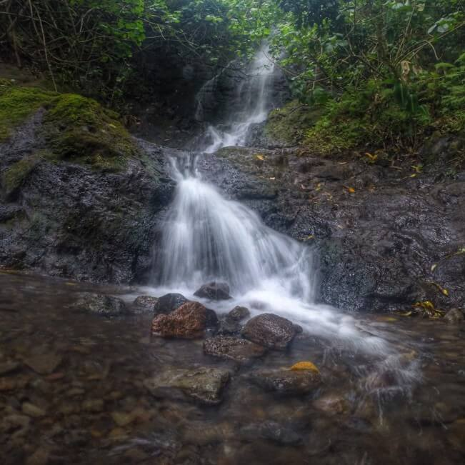 12 Breathtaking Oahu Waterfall Hikes featured by top Hawaii travel blog, Hawaii Travel with Kids | Likeke Falls is a two tiered waterfall on Oahu