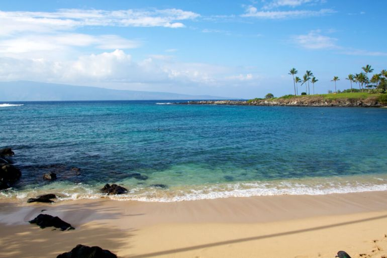 Top 10 Romantic Hawaii Beach Proposal Ideas + Locations featured by top Hawaii blog, Hawaii Travel with Kids: Kapalua Bay on Maui is great for snorkeling