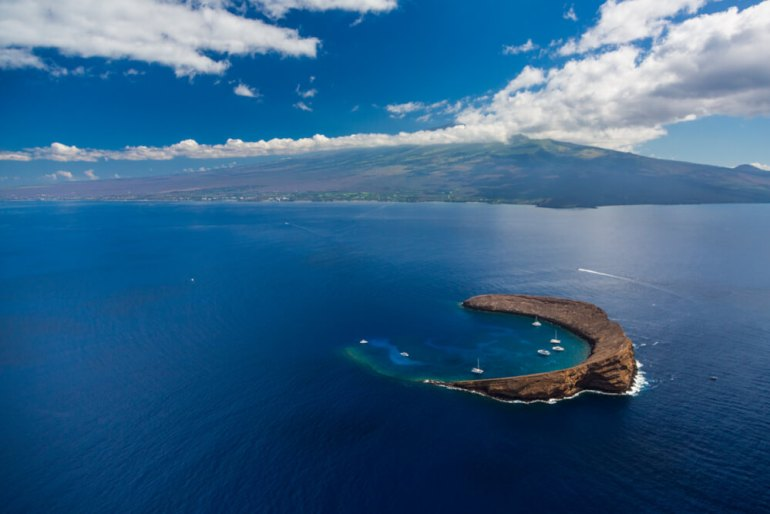 Image of Molokini Crater, a top Maui snorkeling spot that is shaped like a crescent.