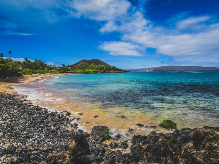 Where to See Turtles in Maui, tips featured by top Hawaii blog, Hawaii Travel with Kids: image of Tranquil turquoise-colored water on the quiet Maluaka Beach, Maui, Hawaii