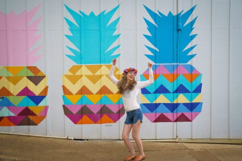 Top 12 Best Photo Opportunities on Kauai featured by top Hawaii travel blog, Hawaii Travel with Kids: The pineapple wall at Kauai Juice Co. in Kapaa is one of the most Instagrammable spots on Kauai.