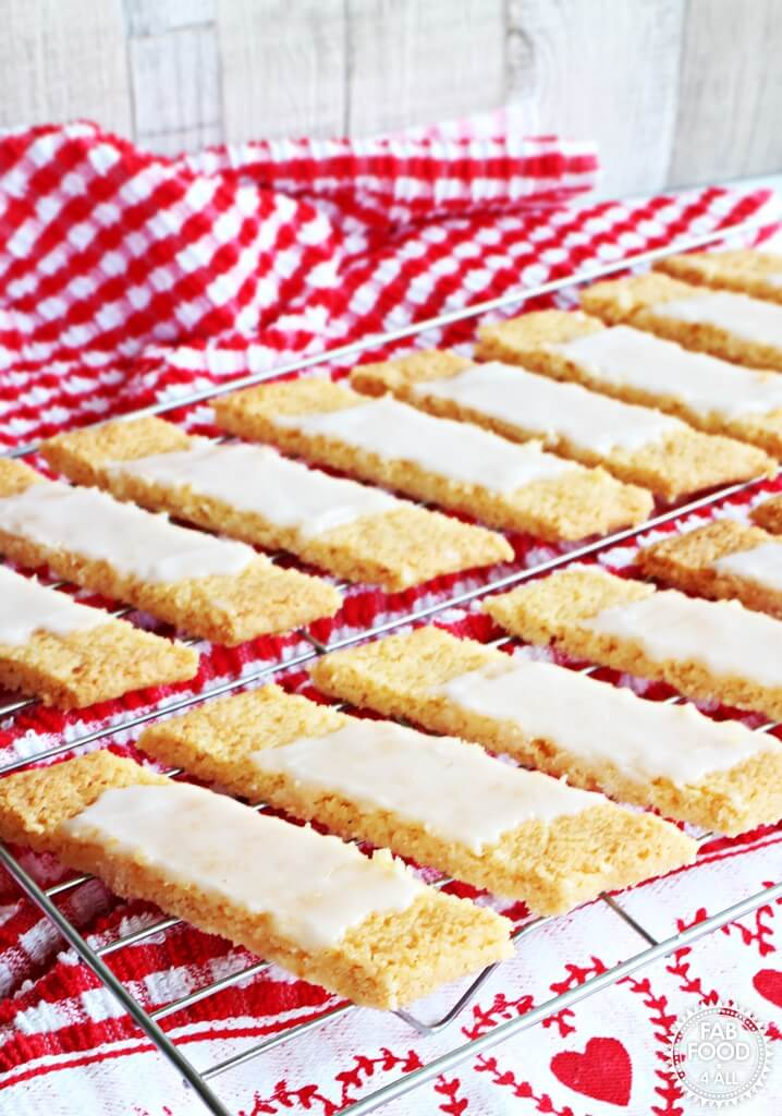 61 Delicious Coconut Dessert Recipes Perfect for Summer featured by top Hawaii blog, Hawaii Travel with Kids: Danish Fedtebrød – Coconut Cookie Slices with Rum Glaze - Fab Food 4 All