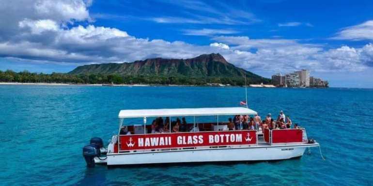 25 Amazing activities in Waikiki with kids featured by top Hawaii blog, Hawaii Travel with Kids: Hawaii Glass Bottom Waikiki boat tour