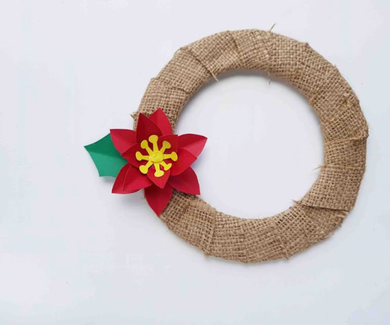 Hawaiian Christmas Decorations: How to Make a Poinsettia Wreath, a step by step tutorial featured by top Hawaii blog, Hawaii Travel with Kids.