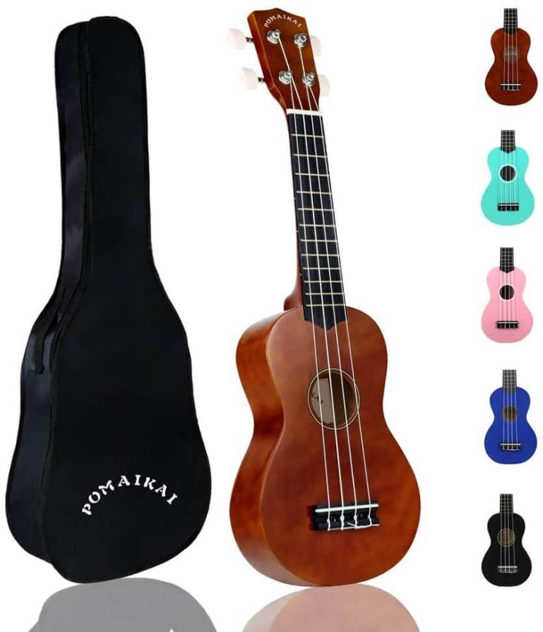 Find out the best kids ukulele to buy in this ukulele guide by top Hawaii blog Hawaii Travel with Kids. Image of POMAIKAI ukulele