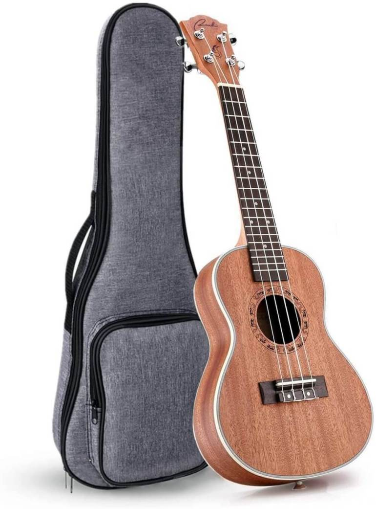 Find out the best left handed ukulele to buy in this ukulele guide by top Hawaii blog Hawaii Travel with Kids. Image of a left handed ukulele