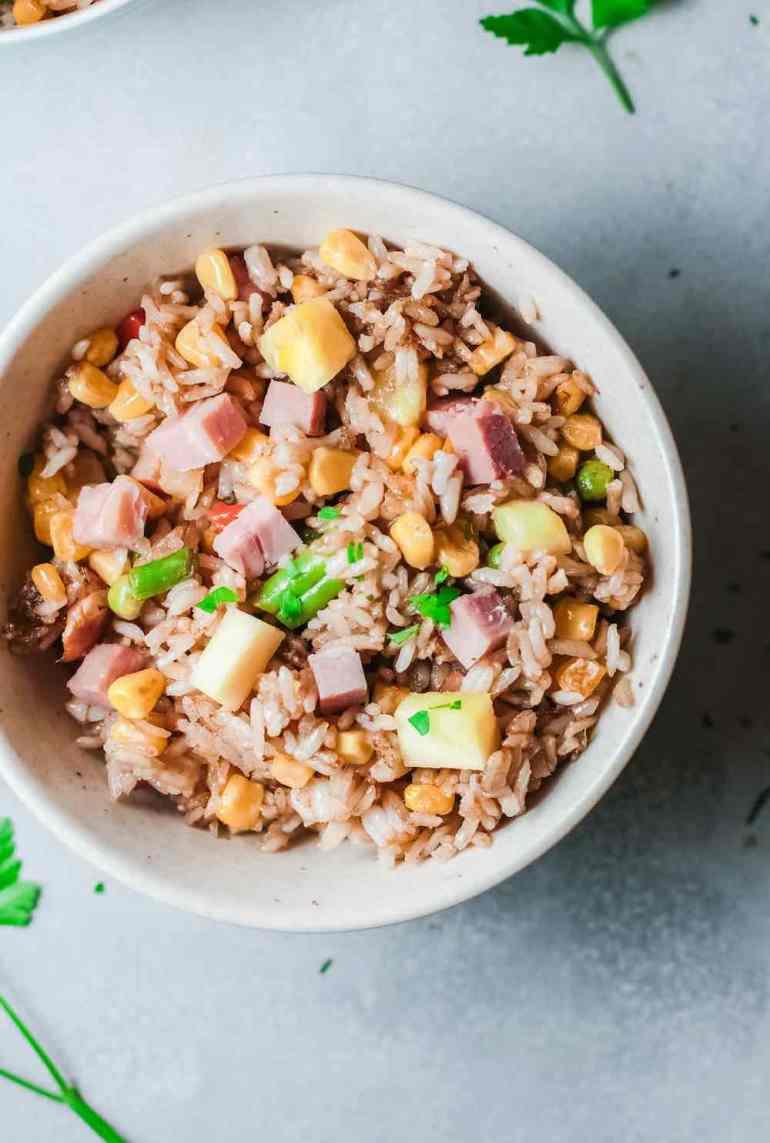 Hawaiian Pineapple Fried Rice Recipe featured by top Hawaii blog, Hawaii Travel with Kids