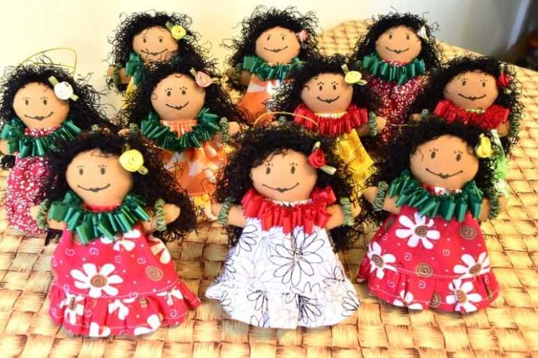 Best Hawaiian Christmas Decorations featured by top Hawaii blogger, Hawaii Travel with Kids: Add some Hawaiian Christmas decorations to your home this holiday season with these top Hawaii Christmas decorations ideas from top Hawaii blog Hawaii Travel with Kids. Image of Hawaiian Keepsake Christmas Doll Ornaments