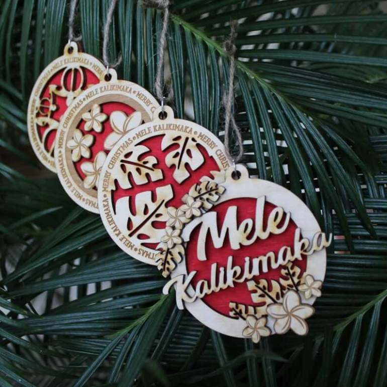 Best Hawaiian Christmas Decorations featured by top Hawaii blogger, Hawaii Travel with Kids: Add some Hawaiian Christmas decorations to your home this holiday season with these top Hawaii Christmas decorations ideas from top Hawaii blog Hawaii Travel with Kids. Image of Mele Kalikimaka Ornaments