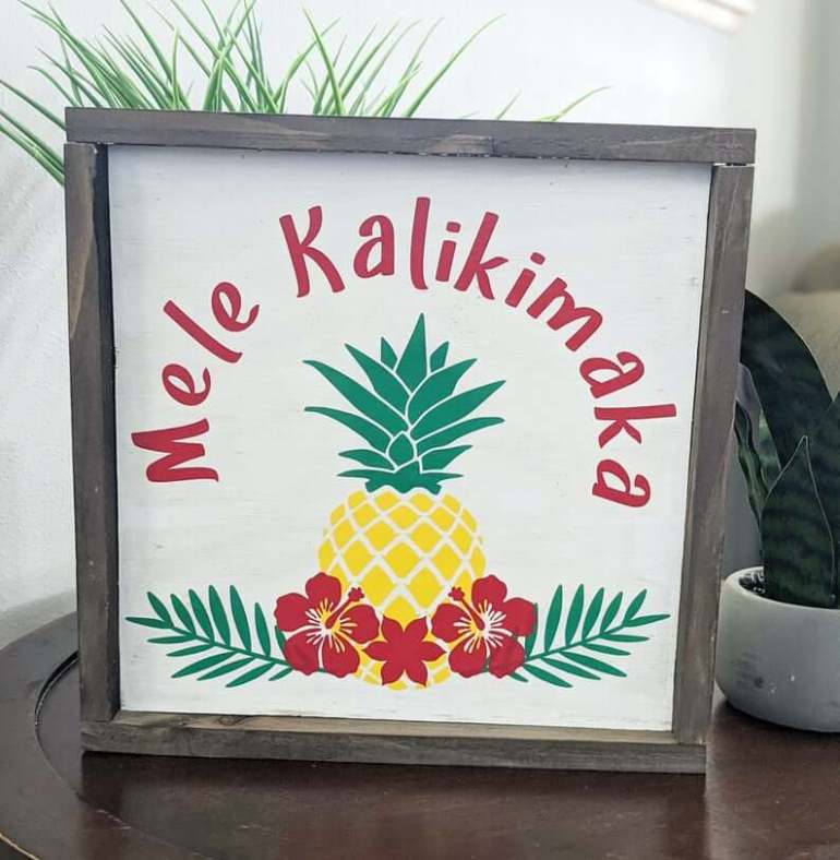 Best Hawaiian Christmas Decorations featured by top Hawaii blogger, Hawaii Travel with Kids: Add some Hawaiian Christmas decorations to your home this holiday season with these top Hawaii Christmas decorations ideas from top Hawaii blog Hawaii Travel with Kids. Image of Mele Kalikimaka sign