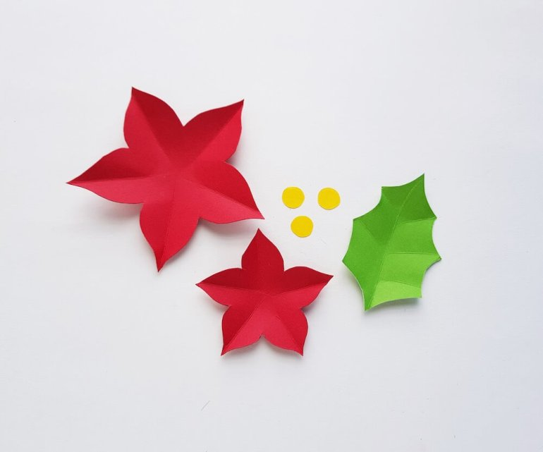 How to Make a Paper Poinsettia Craft, a tutorial featured by top Hawaii blog, Hawaii Travel with Kids: Image of pieces of paper cut out and folded