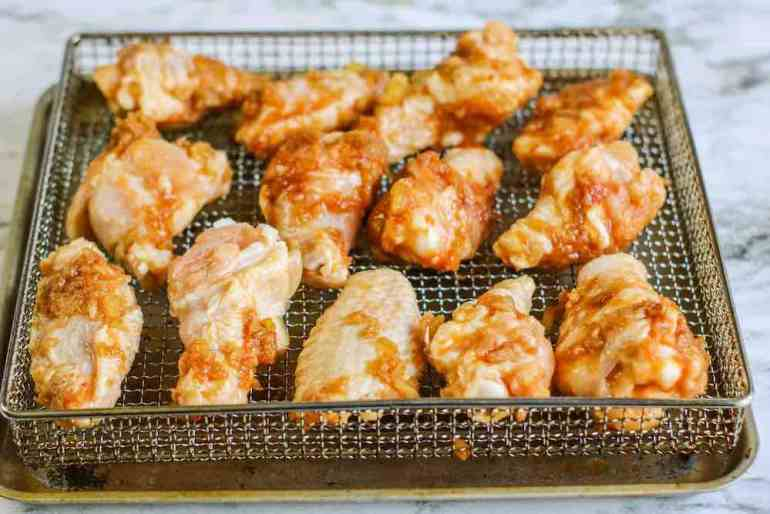 Air Fryer Hawaiian BBQ Chicken Wings Recipe featured by top Hawaii blogger, Hawaii Travel with Kids: Place the marinated chicken wings on the air fryer basket