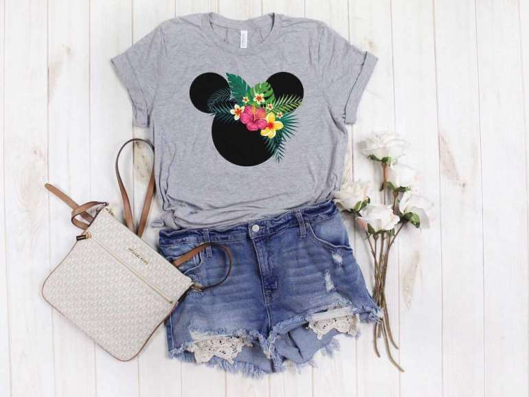 Find out the cutest Disney Aulani t-shirts to buy before your trip to Disney's Aulani Resort in Hawaii by top Hawaii blog Hawaii Travel with Kids. Love this Mickey Mouse shirt with gorgeous Hawaiian flowers on it.