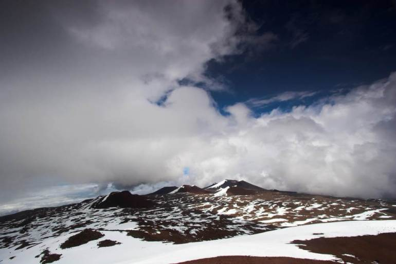 Yes, that's snow at Mauna Kea on the Big Island. Image of Volcanic landscape and snow on the summit of Mauna Kea in Hawaii