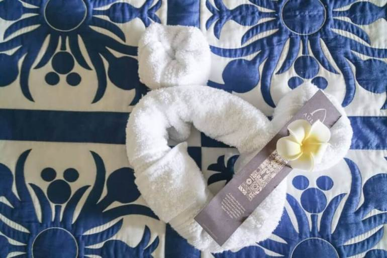 Aulani tips and Disney Aulani Resort review featured by top Hawaii blog, Hawaii Travel with Kids: Photo of a Mickey Mouse towel display at Aulani Resort in Hawaii #aulani #oahu