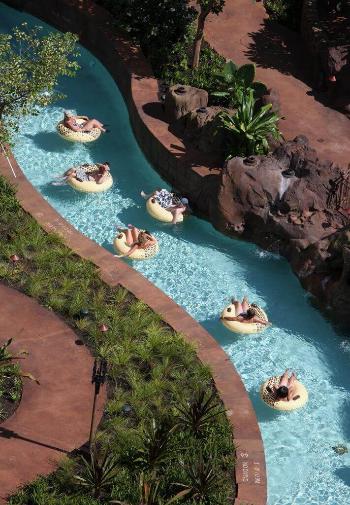 Aulani tips and Disney Aulani Resort review featured by top Hawaii blog, Hawaii Travel with Kids: Photo of Waikolohe Stream at Disney Aulani Resort on Oahu in Hawaii. One of my Aulani tips is to plan for several hours on this lazy river.