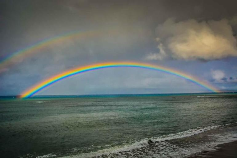 Image of a double rainbow over Kahana Beach in Maui