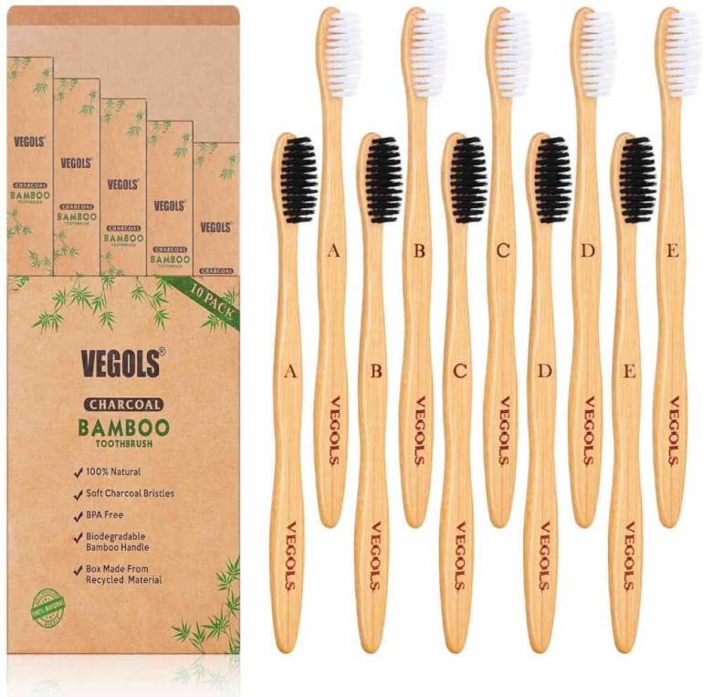 One of the best zero waste bathroom essentials are bamboo toothbrushes. Image of a set of charcoal bamboo toothbrushes by Vegols.