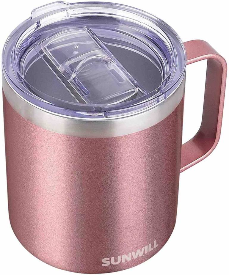 Another one of the best zero waste essentials is a reusable travel coffee mug. Image of a rose pink stainless steel coffee mug.