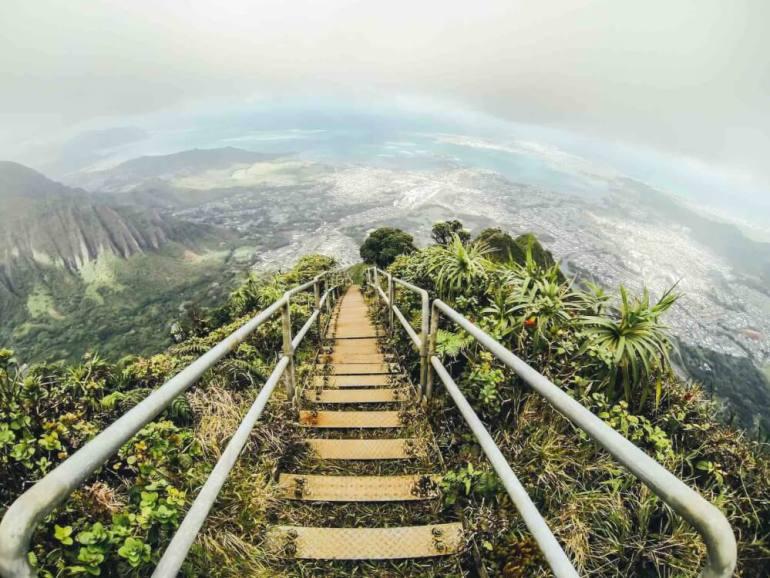 Don't hike the Stairway to Heaven (aka Haiku Stairs) on Oahu, Hawaii. Image of a staircase through the lush greenery of a Hawaii mountain.